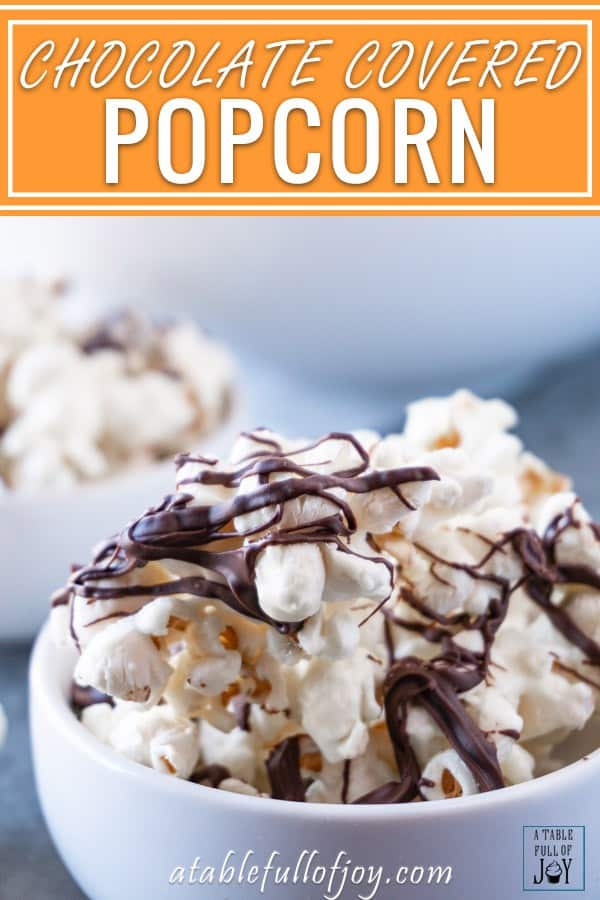 This chocolate drizzled popcorn is easy to make and super addicting! Three ingredients is all it takes to make this yummy treat! #popcorn #chocolate #whitechocolate #atablefullofjoy #party #forkids #easytomake