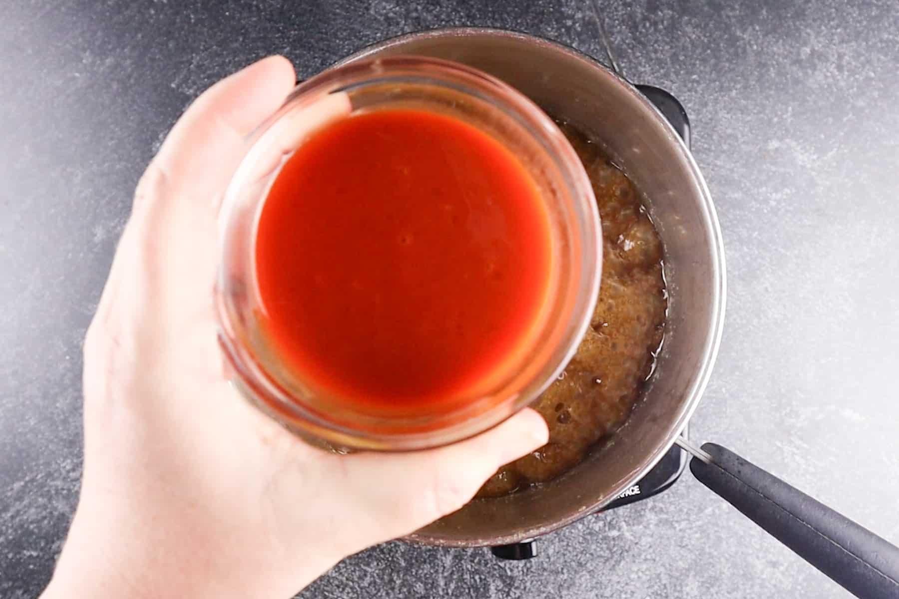 adding hot sauce to caramel