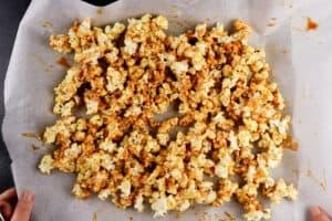 popcorn on baking sheet after stirring