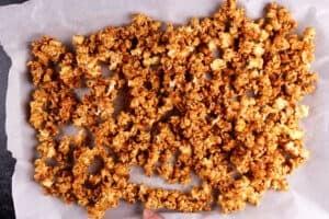 buffalo popcorn on baking sheet after baking