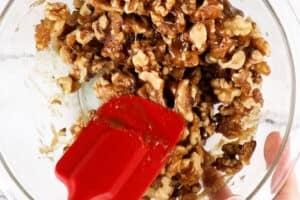 mixing walnuts in sugar mixture