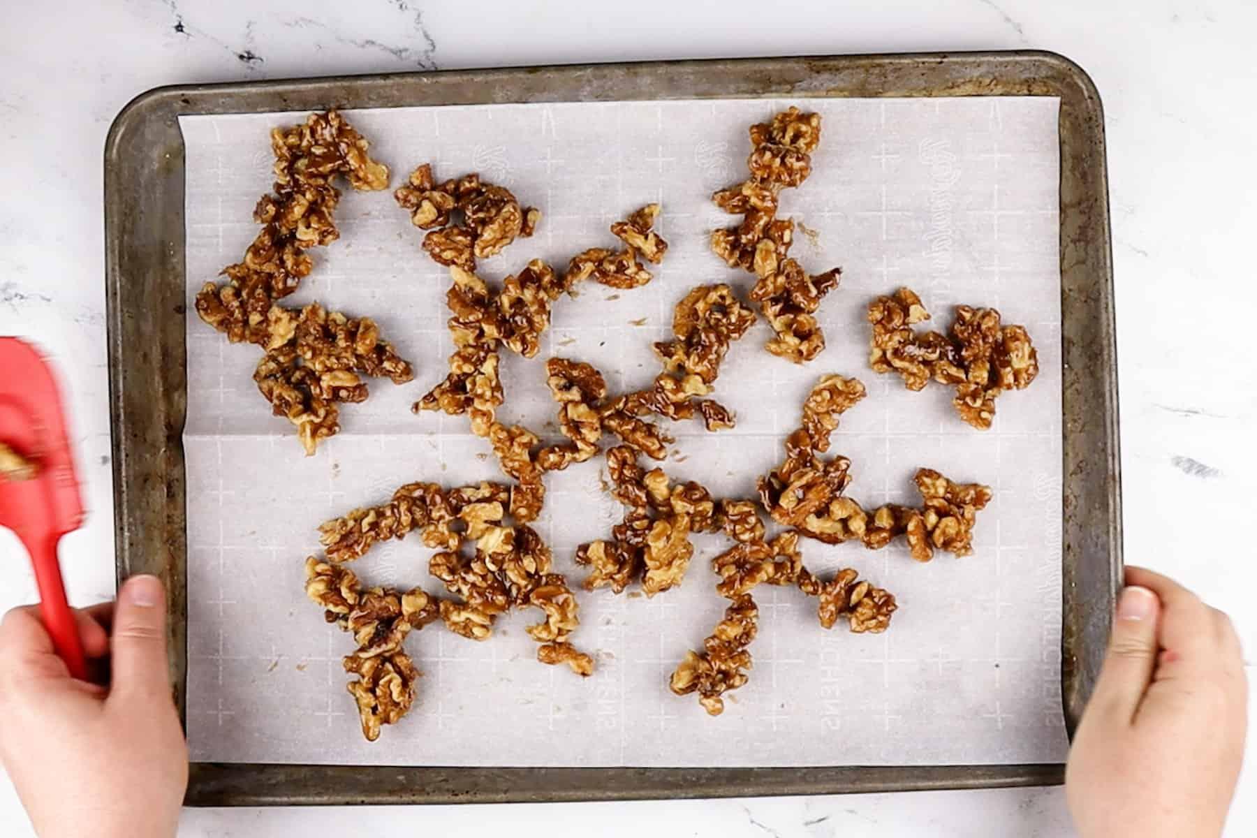 walnuts on baking sheet before baking