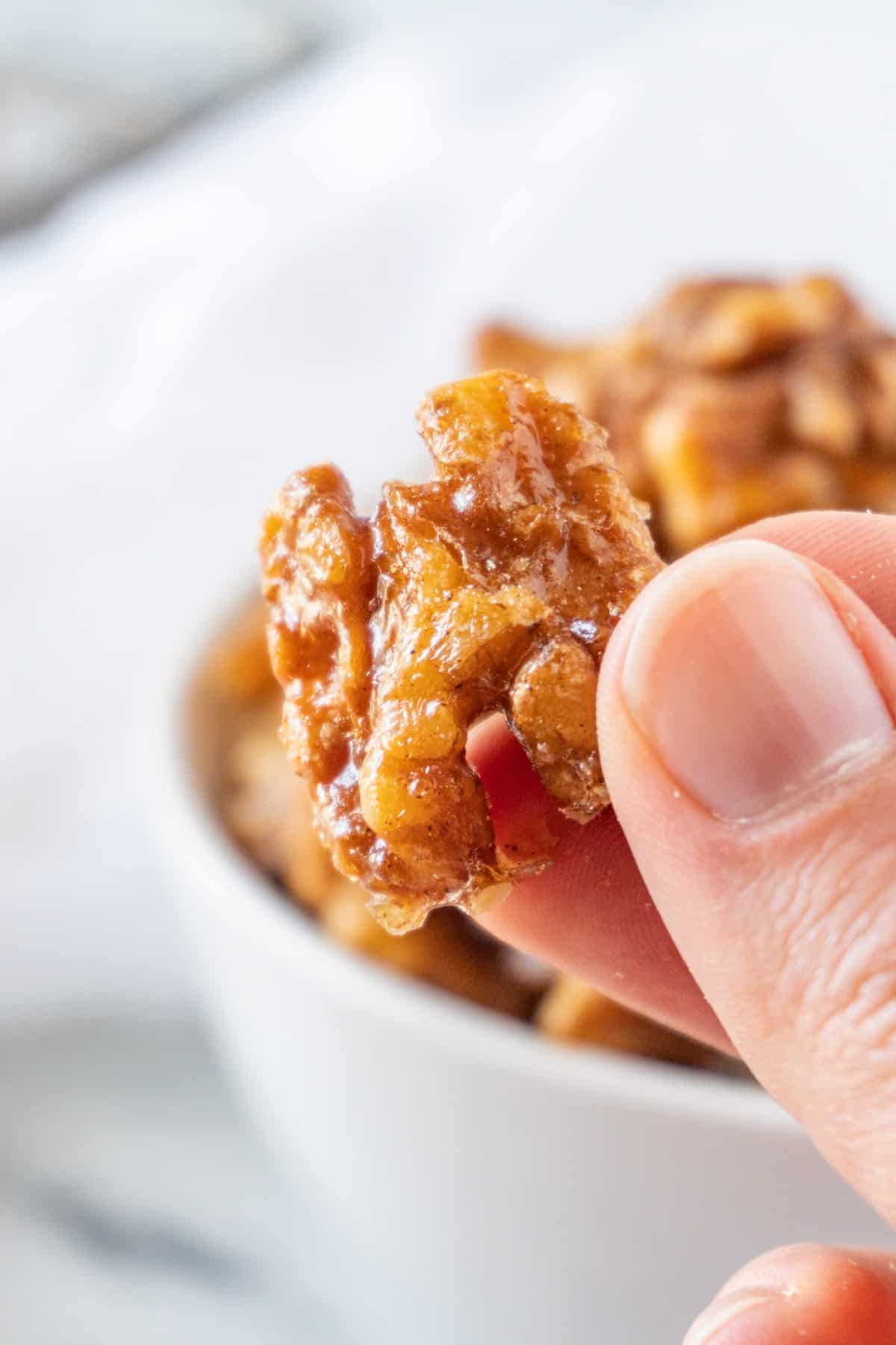holding a candied walnuts