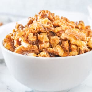 candied walnuts in white bowl featured image