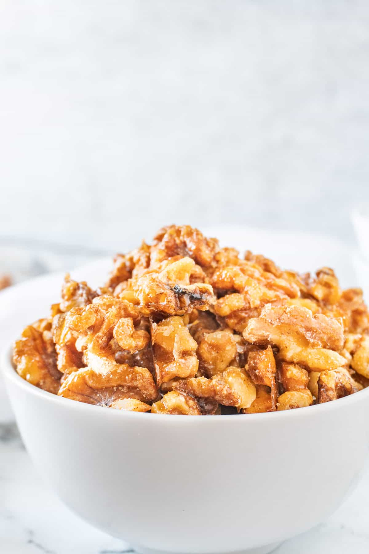candied walnuts in white bowl