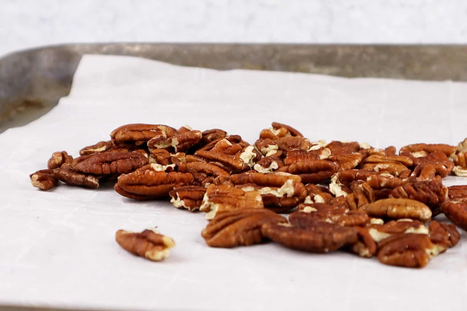 pecans on baking sheet