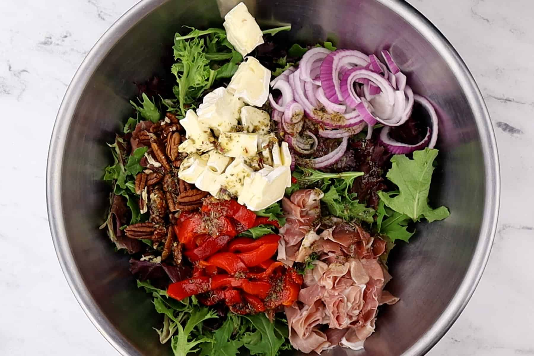 all ingredients for salad in large mixing bowl