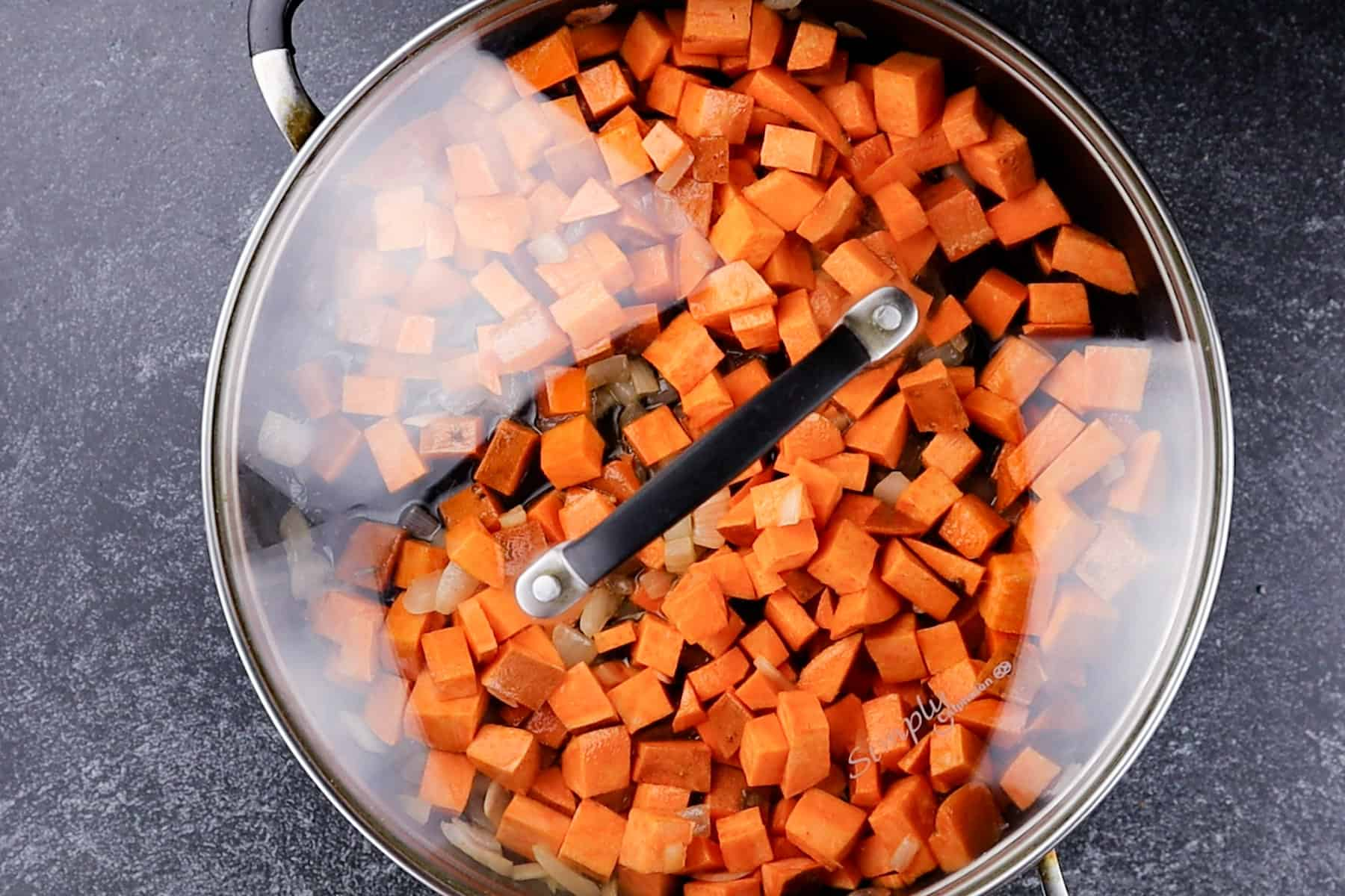 lid on pan with sweet potatoes in it