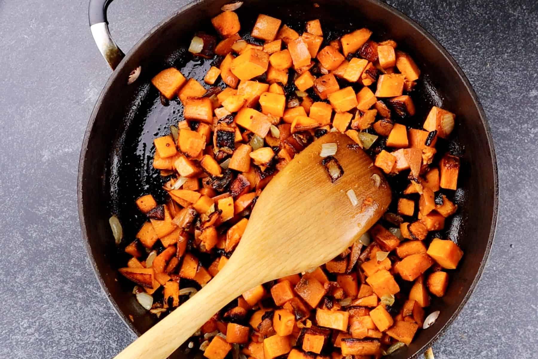 cooked sweet potaotes in pan