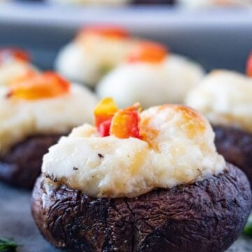 Stuffed Mushrooms, These stuffed mushrooms are easy and delicious! Stuffed with a creamy, cheesy filling you will want to eat these every day! #stuffedmushrooms #mushroom #partyfood #atablefullofjoy #hearthstone #wow #blizzard #gamer #heahstonefood #creamcheese #keto #gf #glutenfree #lowcarb