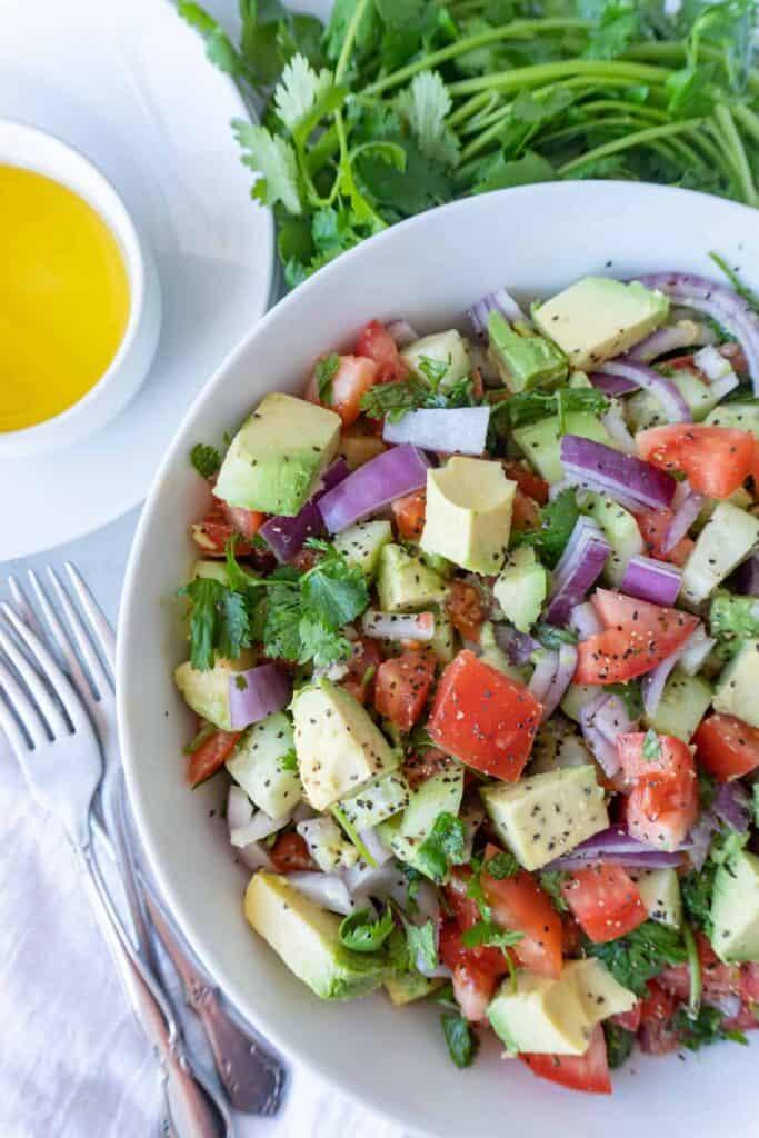 Cucumber Avocado Salad in bowl close up