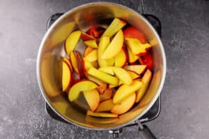 sliced peaches in sauce pan