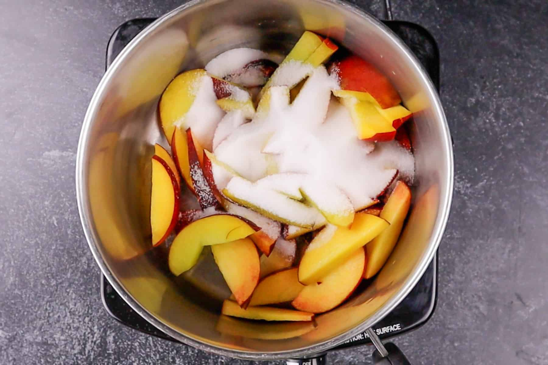 peaches and sugar in sauce pan before heating