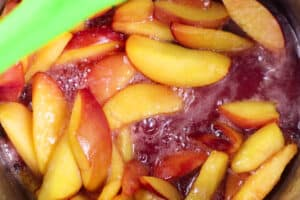 peaches and sugar boiling in sauce pan