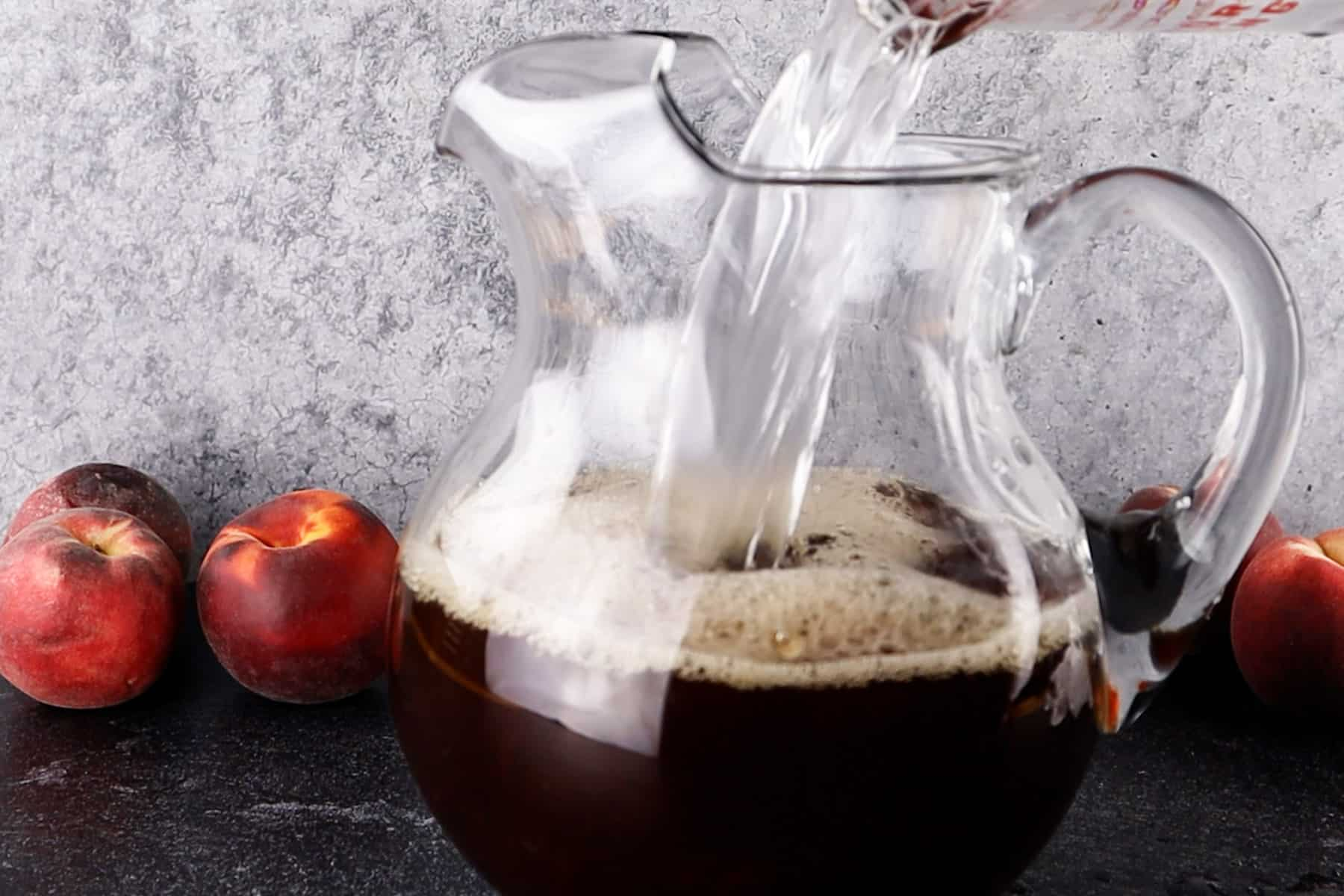 adding water to pitcher