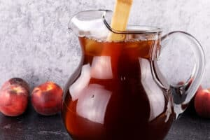 stirring tea in pitcher