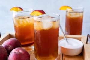 peach tea in 3 glasses
