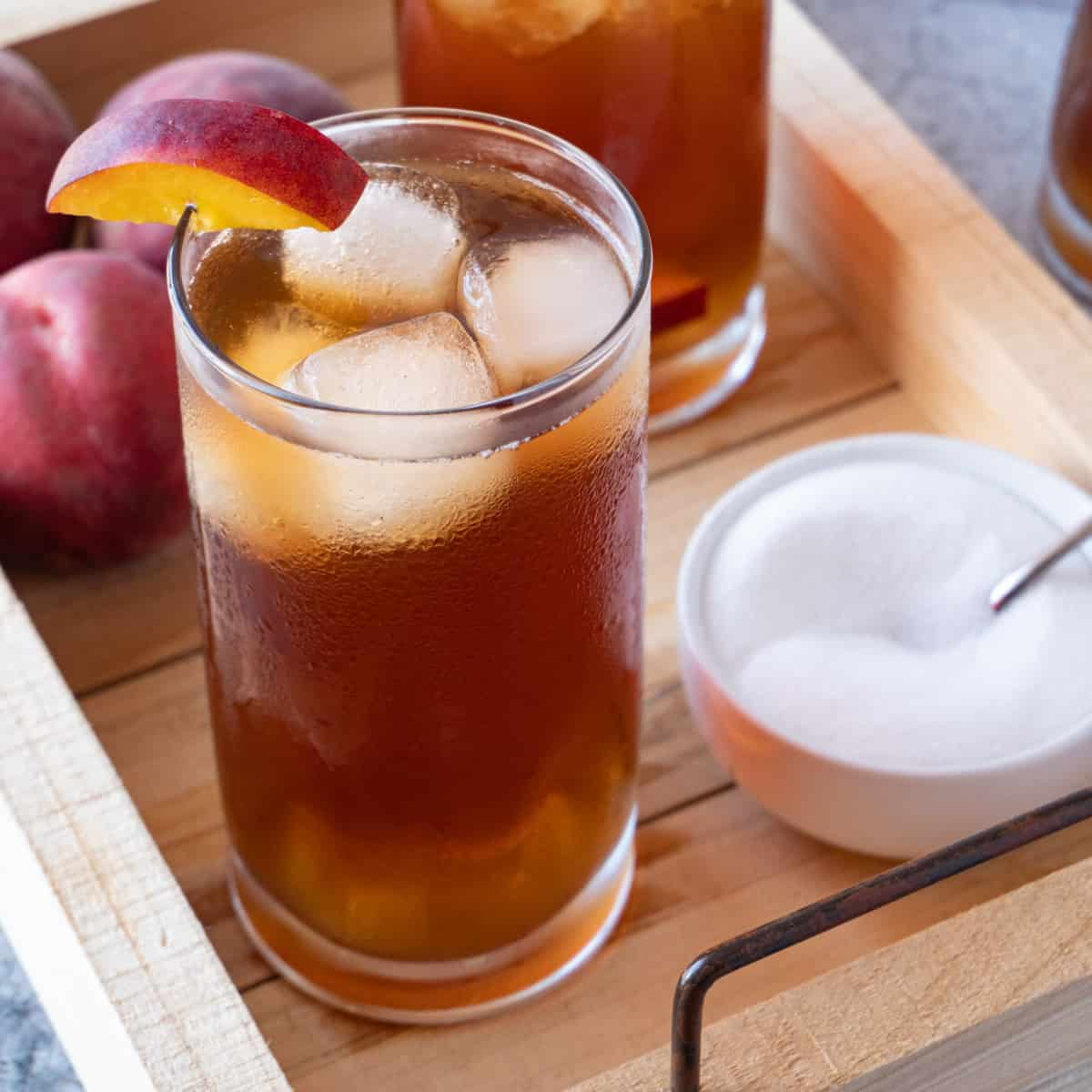 peach tea on wooden tray featured image