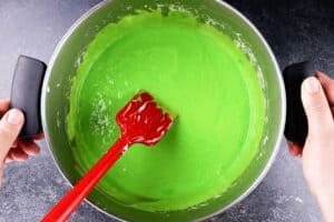 mixing in green food coloring to marshmallow