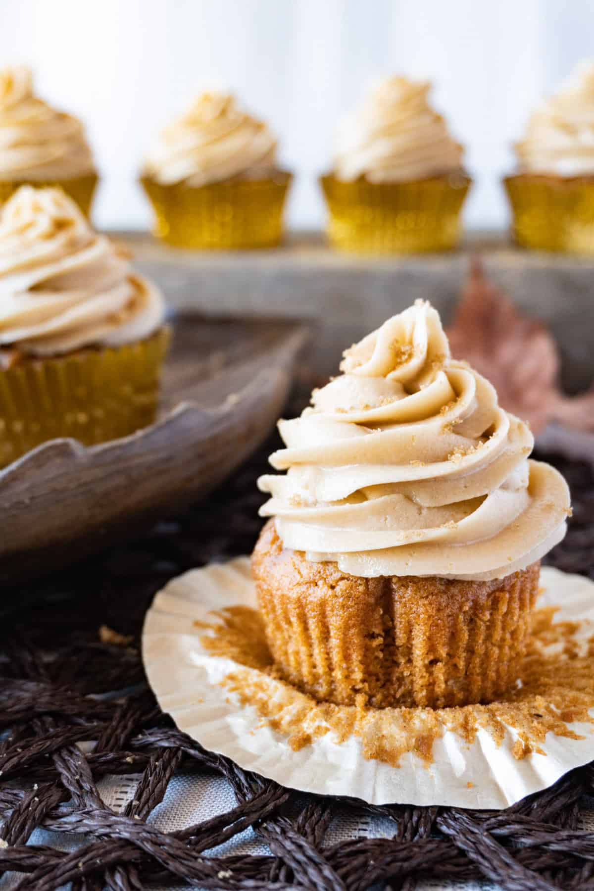 sweet potato cupcake with frosting and cupcakes in background