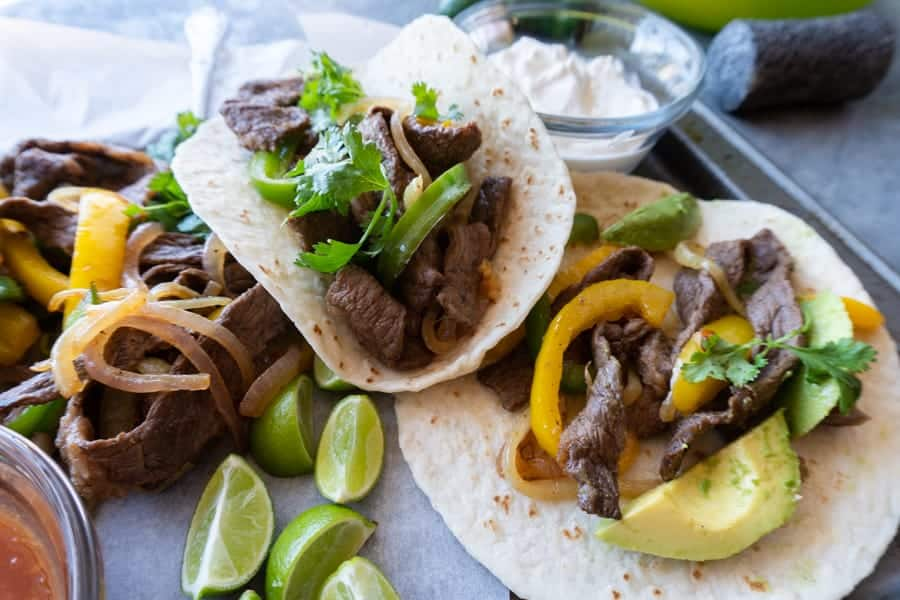 This beef fajita recipe is a one pan easy to make recipe with lots of flavor and served in a delicious tortilla! Dinner couldn't get any better! #atablefullofjoy #taco # tacotuesday #cincodemayo #easydinner #onepan