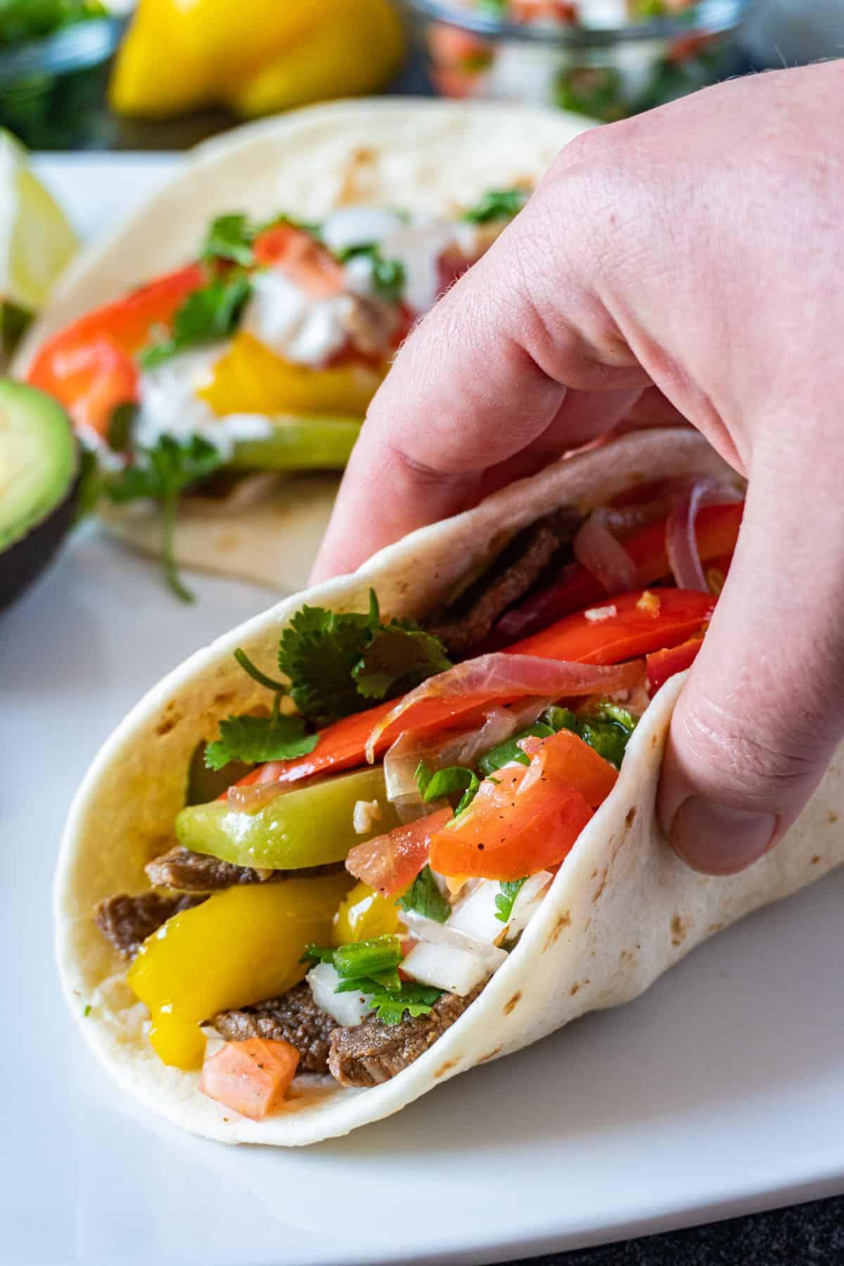 holding a fajita taco