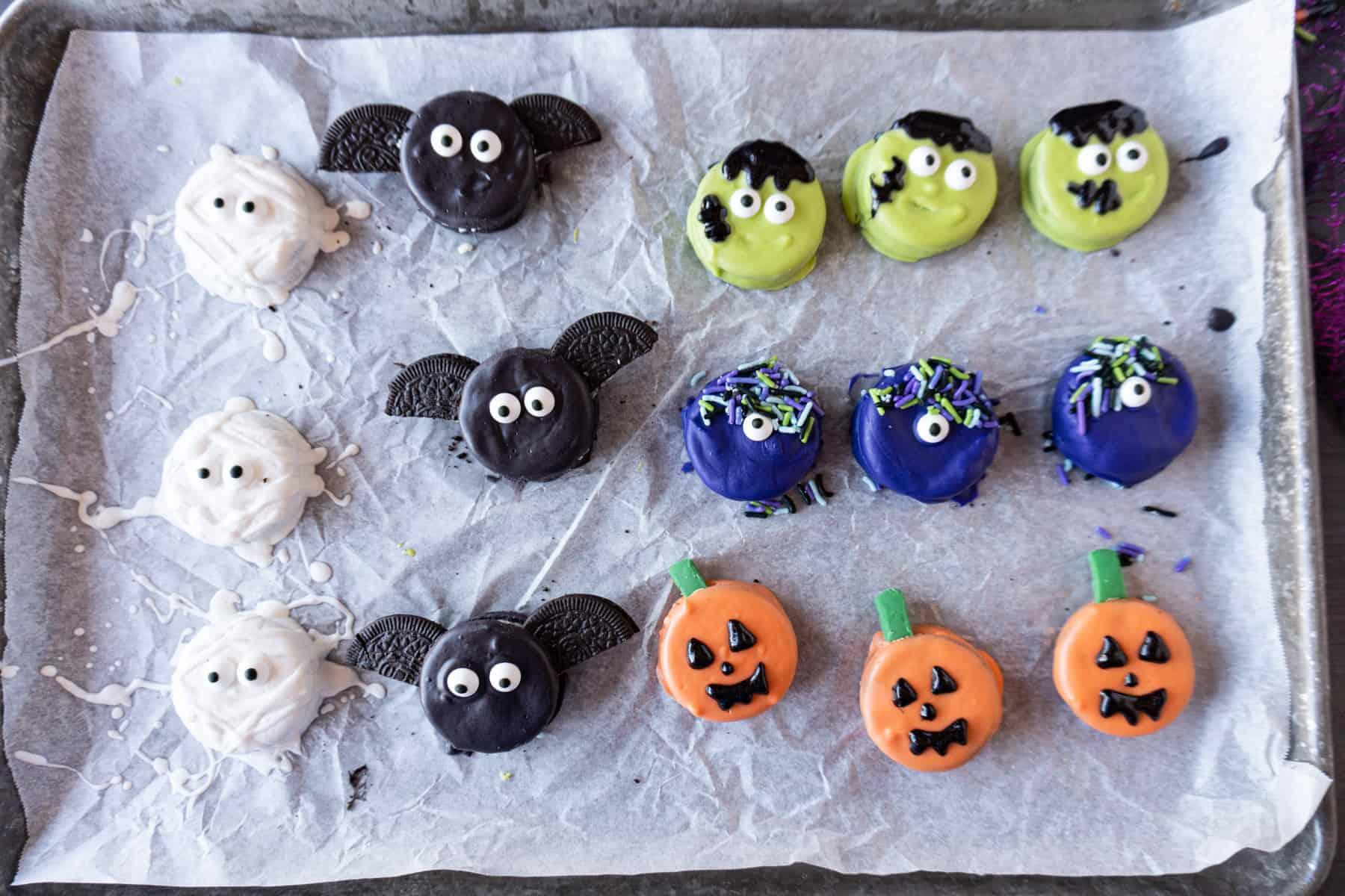 oreo halloween treats on parchment lined baking sheet