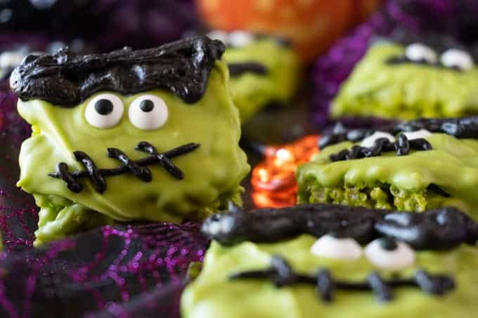 These Frankenstein Halloween Rice Krispie Treats are fun, easy to make, and spookly delicious! #atablefullofjoy #halloween #ricecrispy #ricekrispytreat #frankenstien #monster #party #kidcrafts