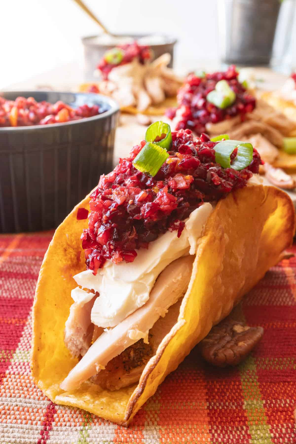 Taco with turkey, cream cheese, cranberry relish and green onion