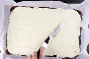 spreading white chocolate over milk chocolate layer