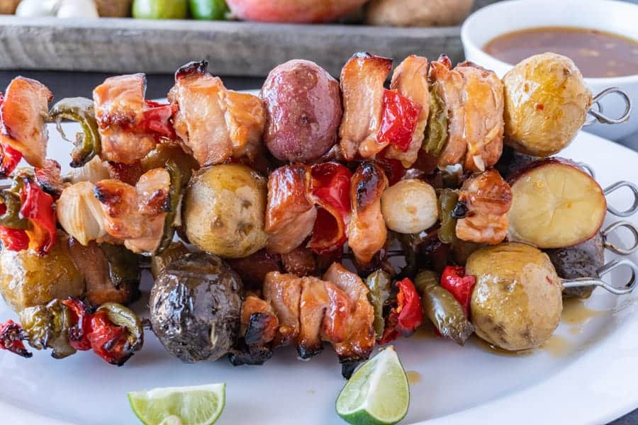 Easy and delicious chicken skewers with the best dipping sauce! These grilled chicken skewers are quick to make and will have everyone asking for more! #chickenskewers #grilled #photography #marinade #BBQ #healthy #atablefullofjoy #easy
