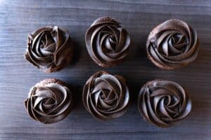cupcakes frosted with dark chocolate buttercream