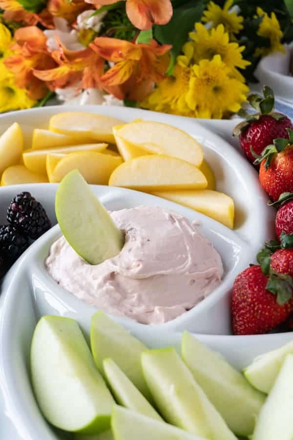 This delicious cream cheese fruit dip is so easy you won't believe it! Serve it up at a gathering or as a yummy treat for your family- everyone will love this cream cheese fruit dip! #babyshower #creamcheese #dip #fruit dip #party #atablefullofjoy #withcreamcheese #withmarhsmallowfluff #recipe