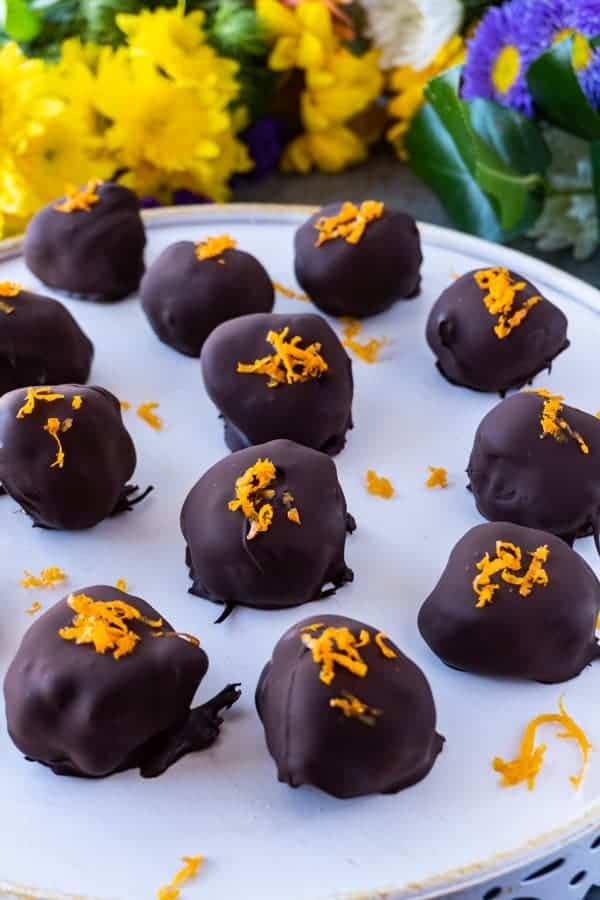 Vegan Truffles,These creamy orange vegan truffles are a delicious treat that are dairy free, bursting with delicious orange flavor, and the perfect sweetness. #truffle #cashewcream #dairyfree #df #gf #glutenfree #paleo #cashew #orange #atablefullofjoy #orangecream #maplesyrup #chocolate #raw #healthy