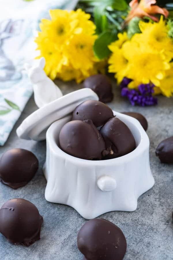Chocolate Peanut Butter Balls, an easy and delicious treat that is the perfect balance of chocolate and peanut butter! #peanutbutter #3ingredients #nobake #atablefullofjoy #easter #peanutbutterballs #easy