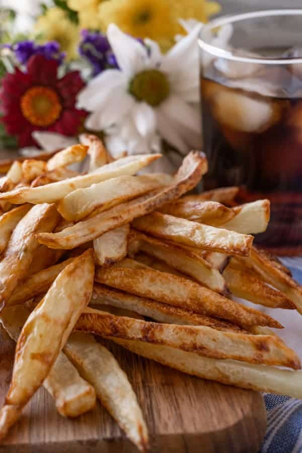 Homemade Baked French Fries, easy to make and deliciously crunchy! #homemade #frenchfries #intheoven #ovenbaked #baked #crispy @atablefullofjoy #recipe #easy