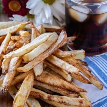 Homemade Baked French Fries, easy to make and deliciously crunchy! #homemade #frenchfries #intheoven #ovenbaked #baked #crispy #atablefullofjoy #recipe #easy