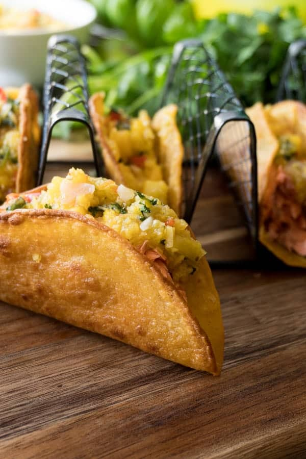 Side view of salmon mango tacos
