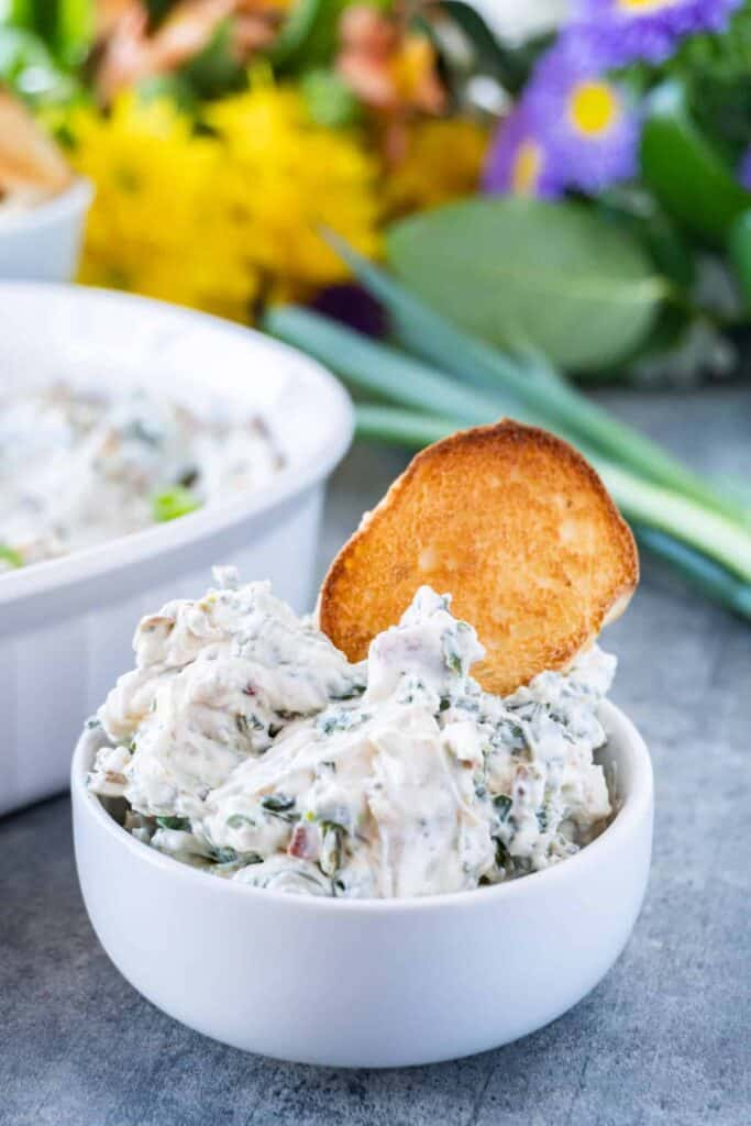 spinach dip close up with toasted bread
