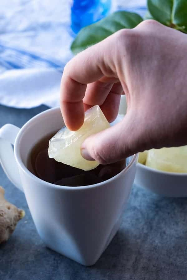 Ginger Juice Ice Cube being added to tea