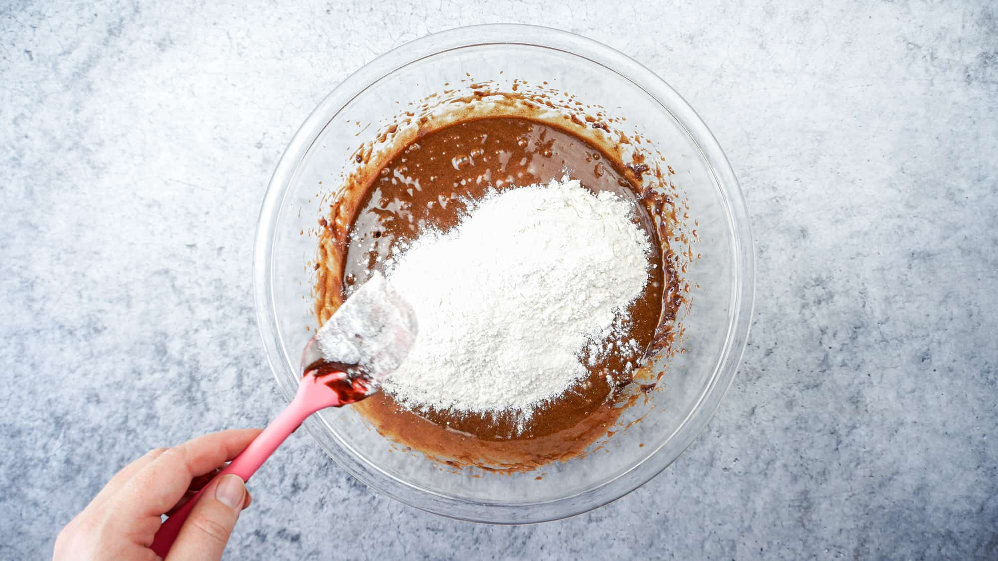 adding flour into brownie batter
