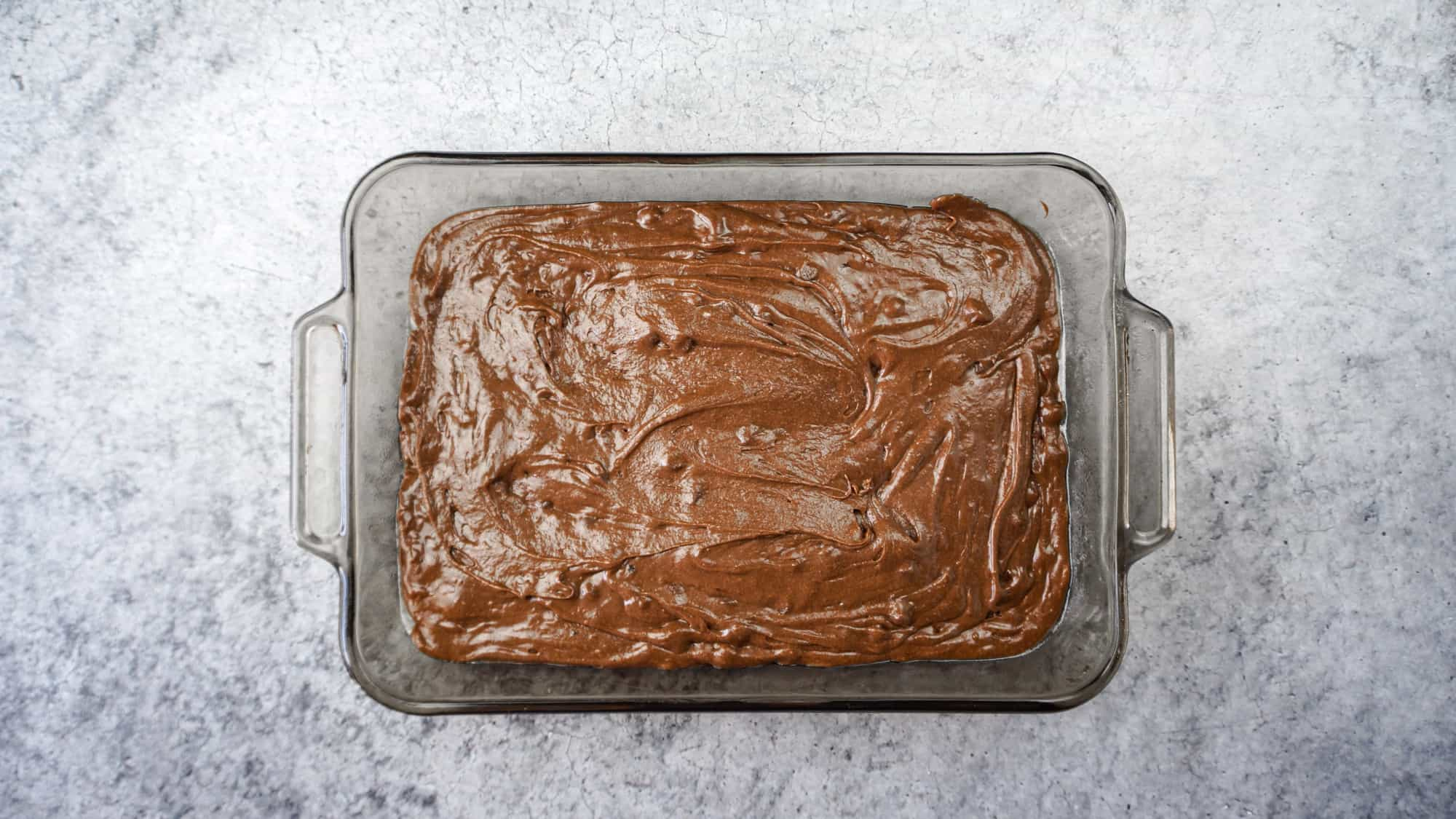 brownie batter in baking dish before baking
