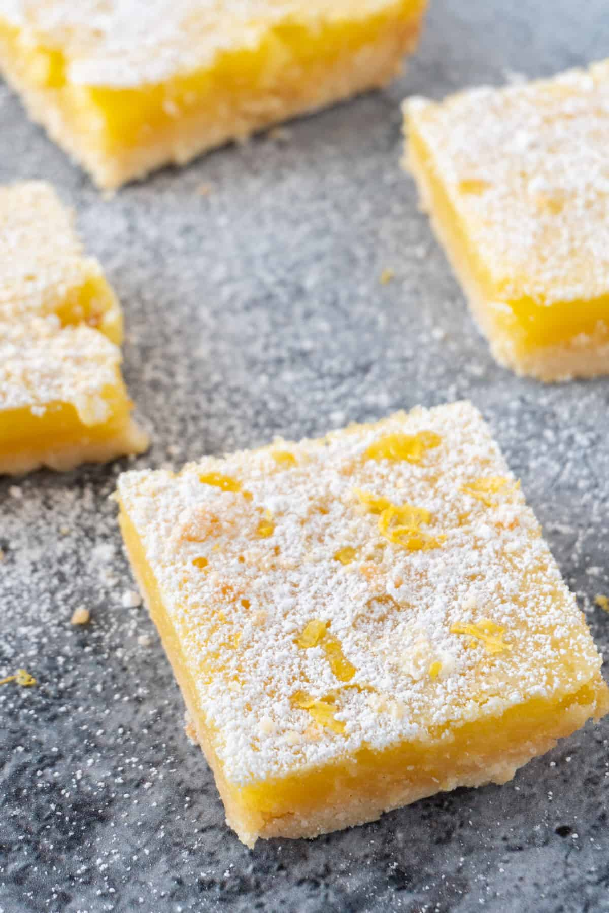 lemon bars from scratch with powdered sugar on top