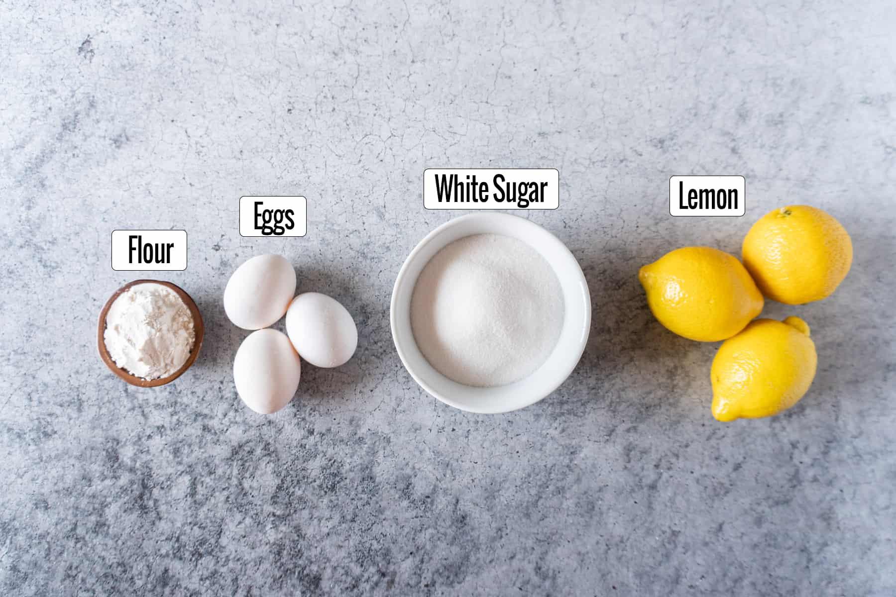 lemon bars ingredients- flour, eggs, sugar, lemons