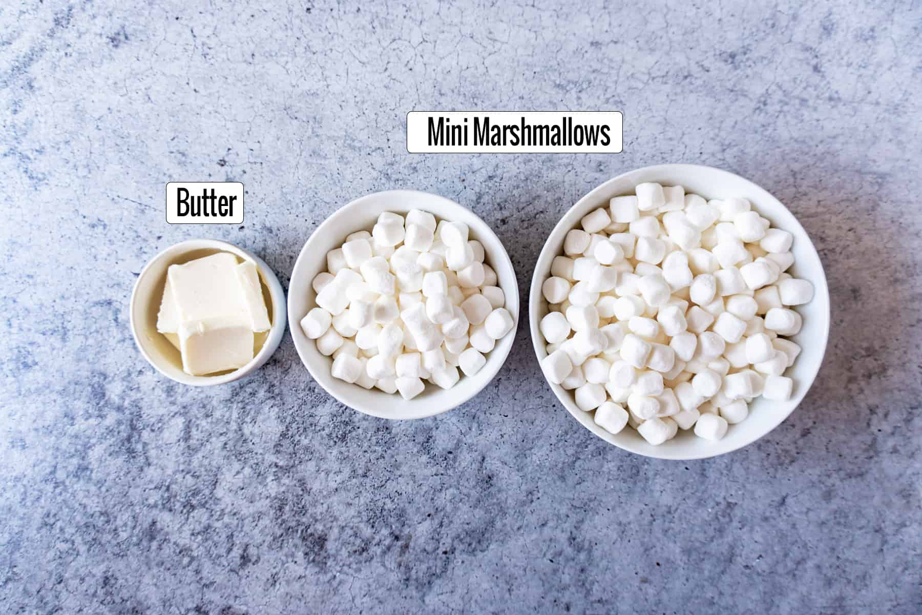 Ingredients in bowls marshmallows and butter