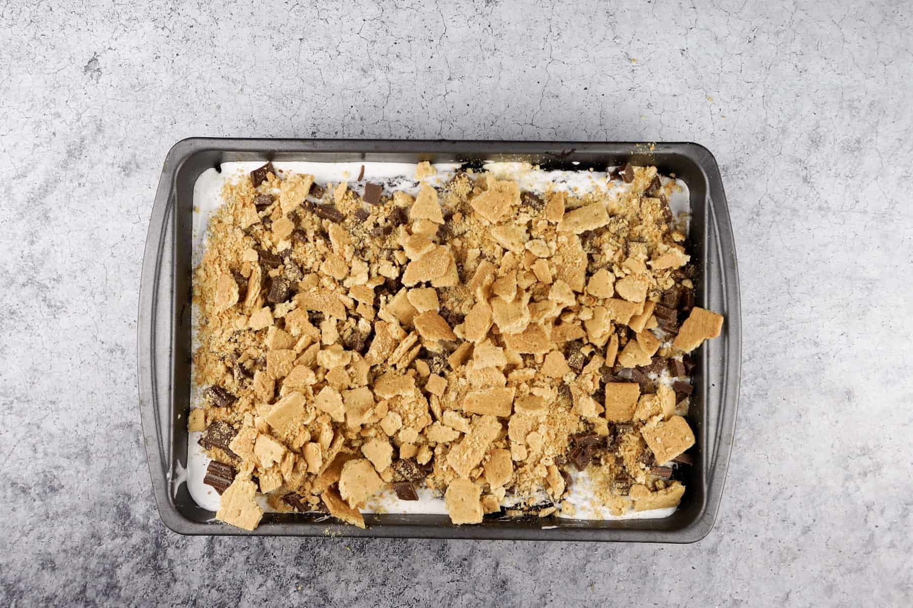 adding crushed graham crackers to brownies