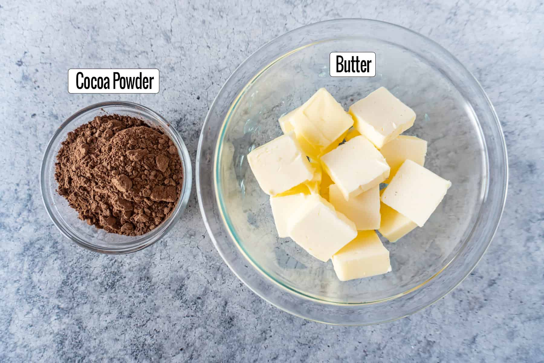 ingredients in bowls: cocoa powder, butter