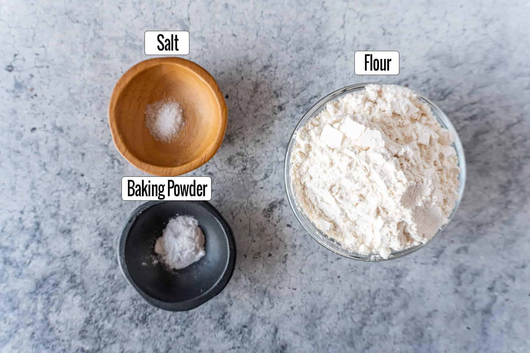 ingredients in bowls: salt. baking powder, flour