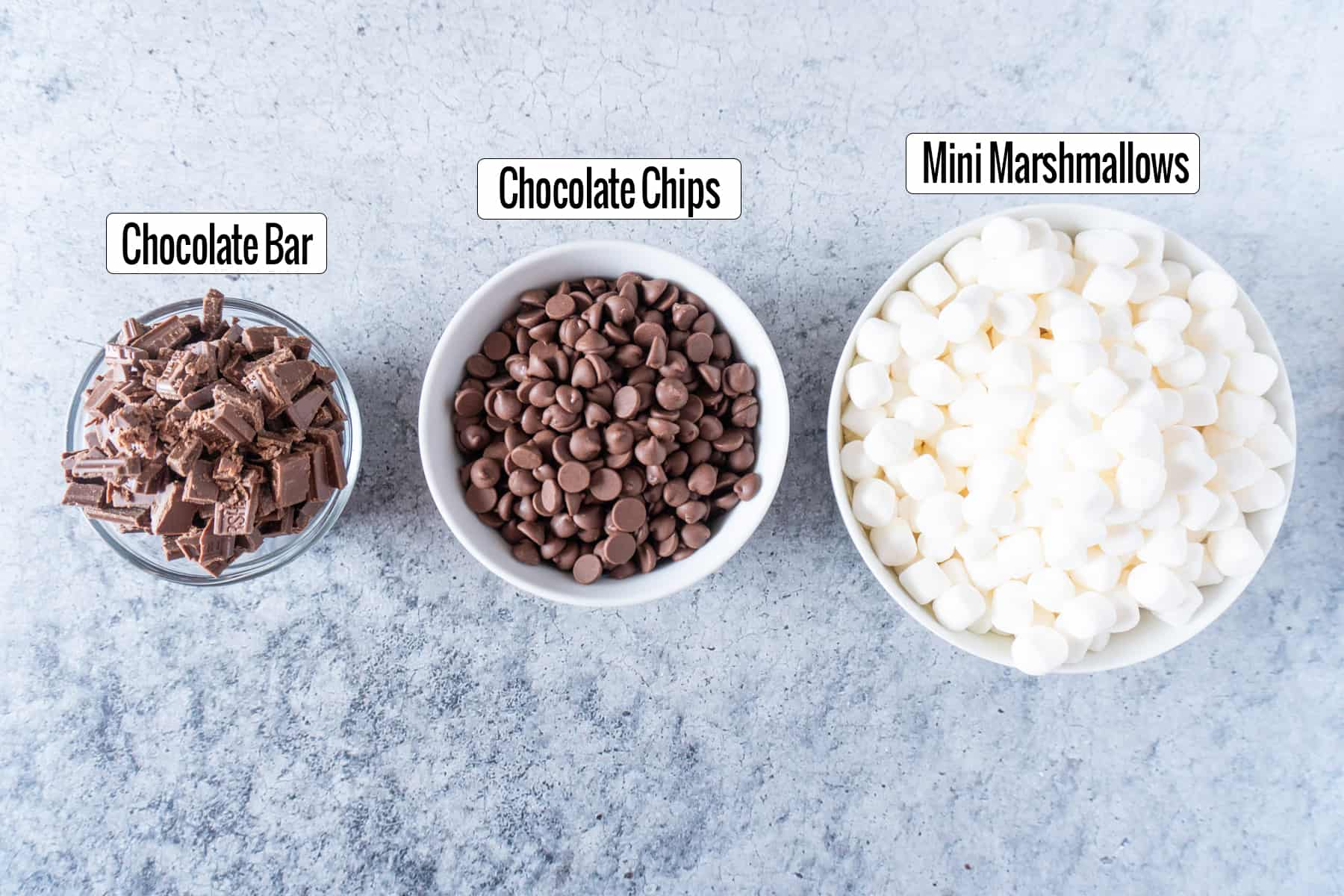 chocolate and marshmallows in bowls