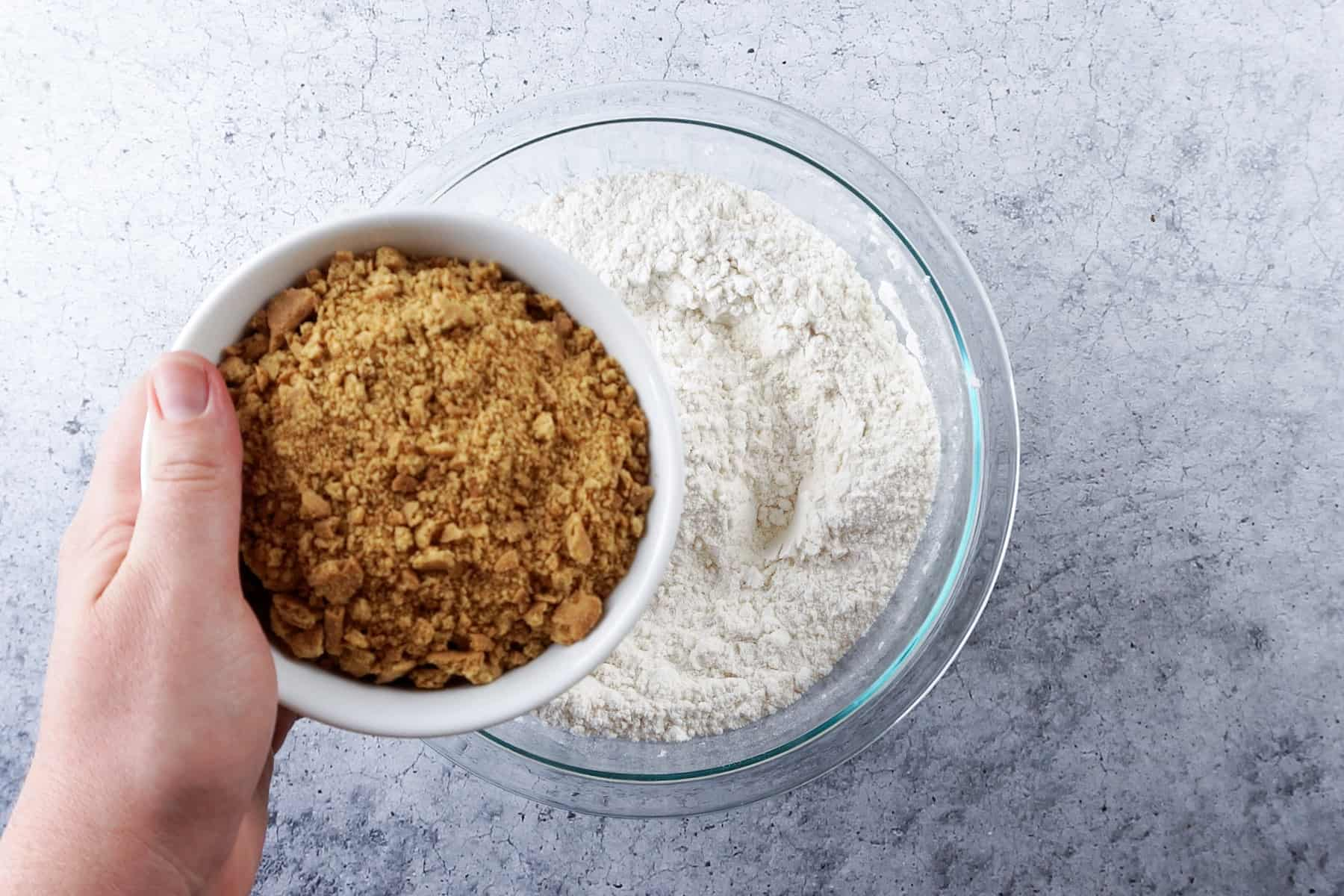 adding crushed graham cracker to the flour mixture